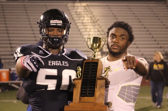 Senior Captains Jalen Howard and Meech Dowd proudly return the City Trophy after their team had to give it up when they were juniors.